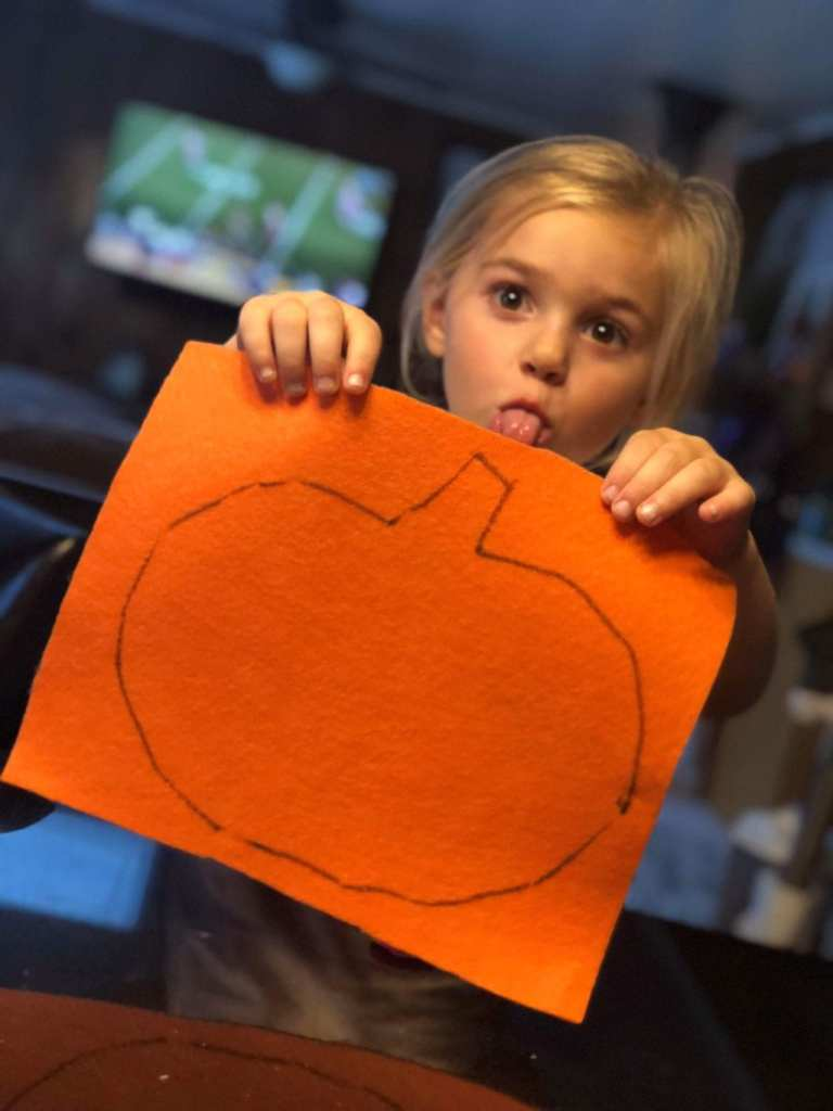 girl with felt pumpkin template
