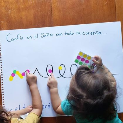 kids placing stickers along different lines