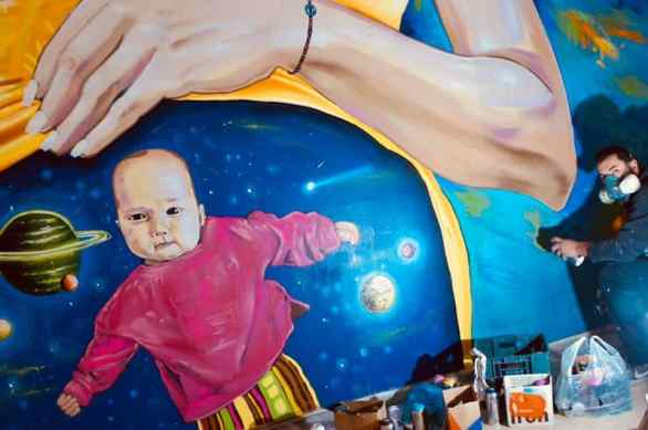 mural of baby in space womb