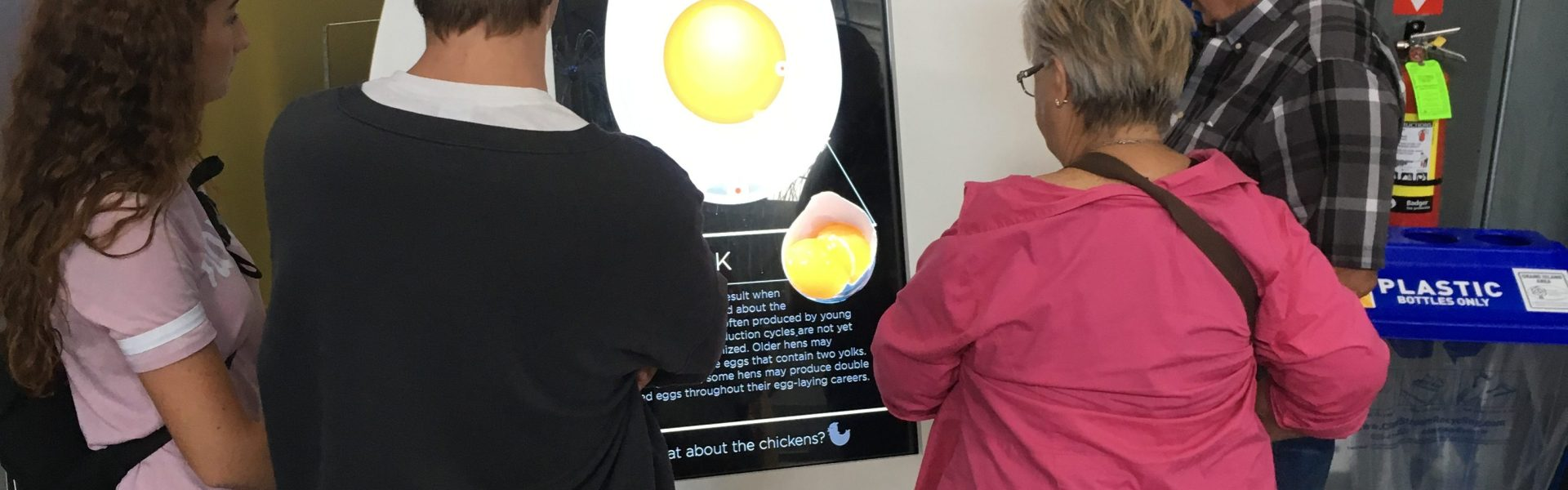 Family looking at Amazing Egg Exhibit