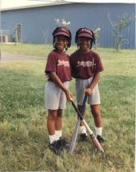 tina and trina as young kids playing softball - encourage kids to stay active and involved in sports