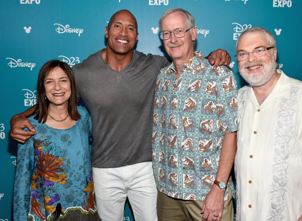"""ANAHEIM, CA - AUGUST 14: (L-R) Producer Osnat Shurer, actor Dwayne Johnson, Directors John Musker and Ron Clements of MOANA took part today in """"Pixar and Walt Disney Animation Studios: The Upcoming Films"""" presentation at Disney's D23 EXPO 2015 in Anaheim, Calif. (Photo by Alberto E. Rodriguez/Getty Images for Disney) *** Local Caption *** Osnat Shurer; Dwayne Johnson; John Musker; Ron Clements"""