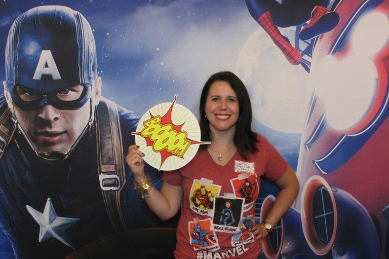 Woman with Marvel T in front of Captain America poster