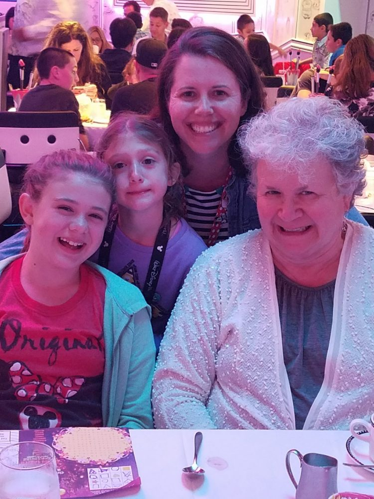 Mother, grandmother, and two girls at dining table