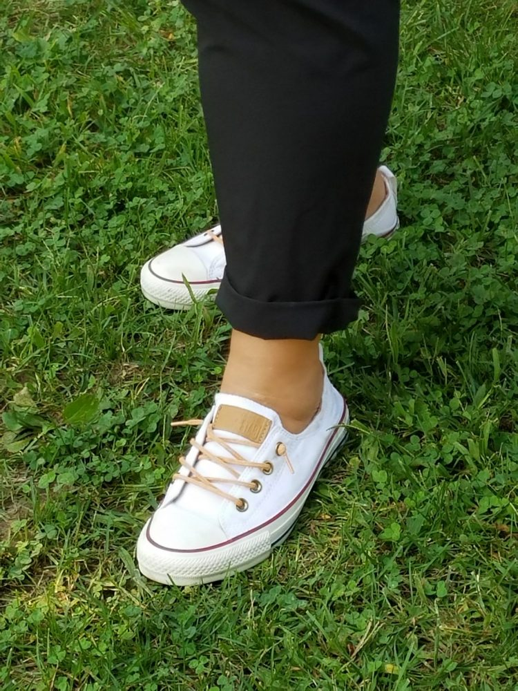 Closeup of pant cuff and white shoes