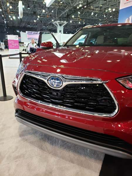 Grill of a red Toyota Highlander 2020 model.