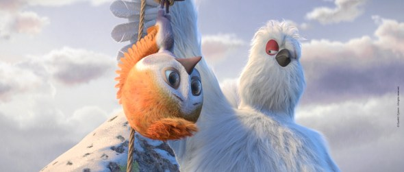 Ploye held upside down by white bird.