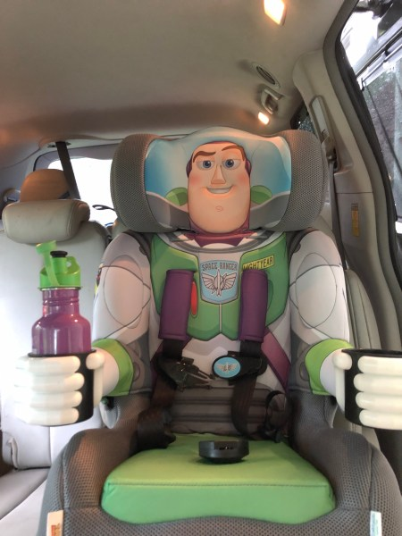 Buzz Lightyear KidsEmbrace booster seat installed on a seat.