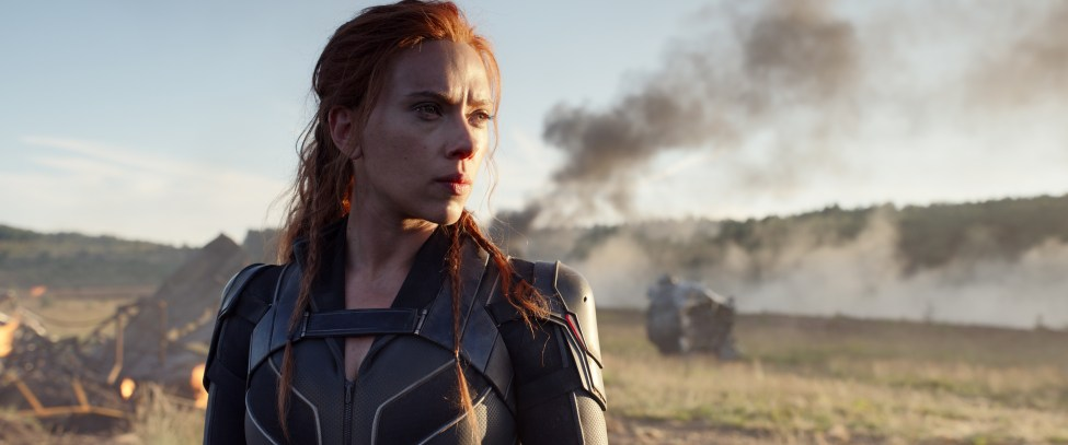 Black Widow standing in front of a crash site