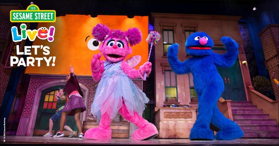 Sesame Street Live characters dancing.