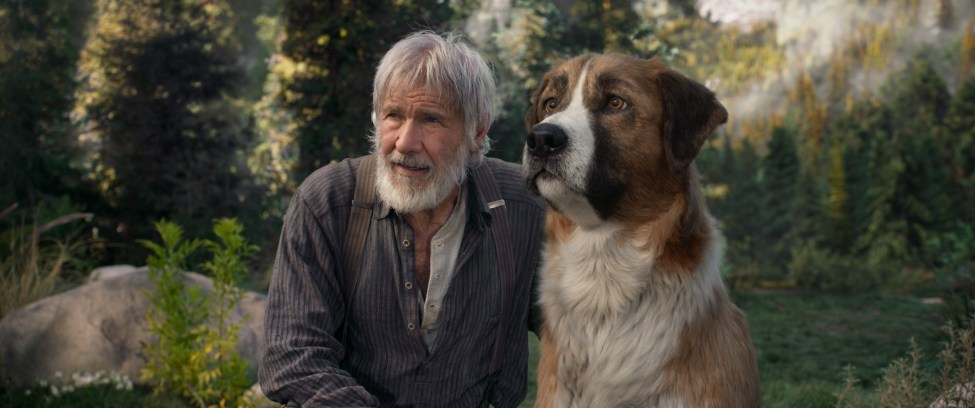 Harrison Ford with dog in the woods