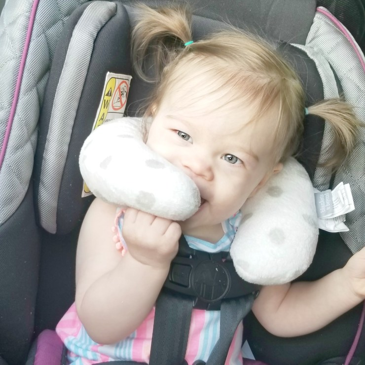 Child with Neck Pillow