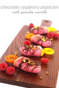 Chocolate raspberry popsicles with pistachio crumble