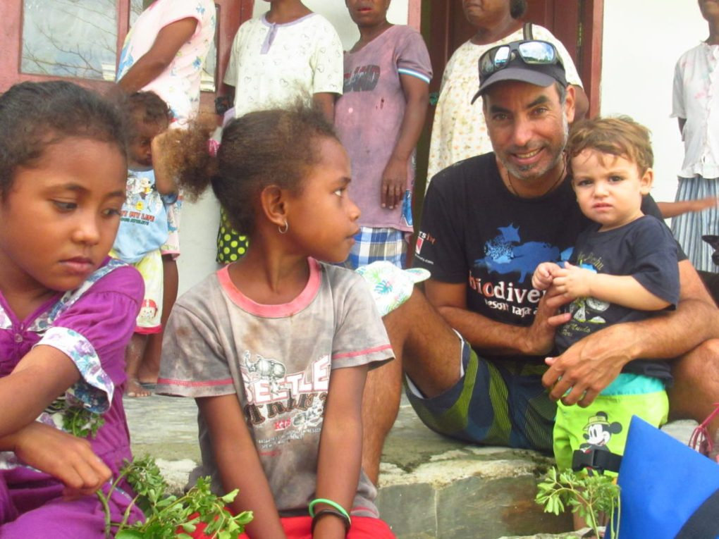 reynaldo and the kids - Community Program in raja ampat