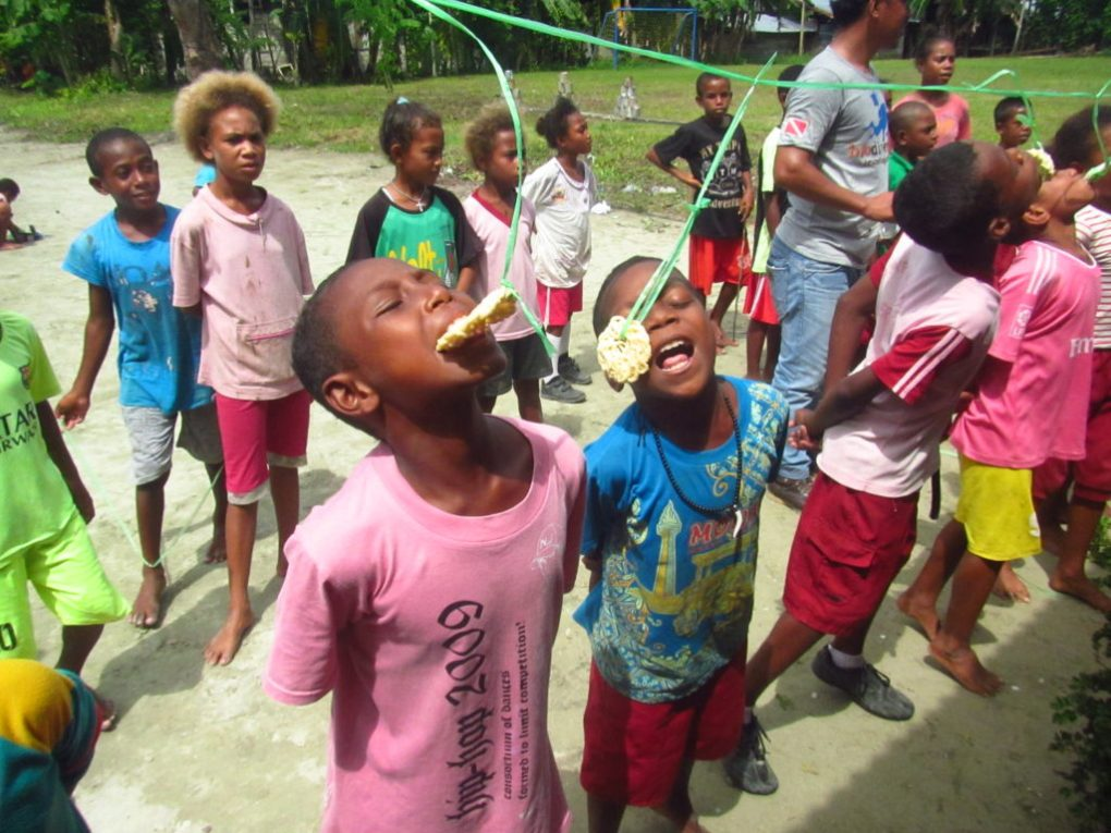 community program in raja ampat playing kids