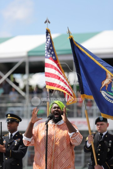 Jun 5, 2016; Detroit, MI, USA; Recording artist Tunde Olaniran sings the national anthem before the Chevrolet Dual in Detroit Race 2 at The Raceway at Belle Isle Park. Mandatory Credit: Raj Mehta-USA TODAY Sports