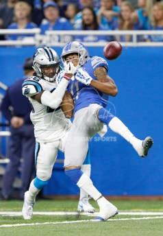 Oct 8, 2017; Detroit, MI, USA; Carolina Panthers cornerback Daryl Worley (26) commits a pass interference against Detroit Lions wide receiver Marvin Jones (11) during the first quarter at Ford Field. Mandatory Credit: Raj Mehta-USA TODAY Sports
