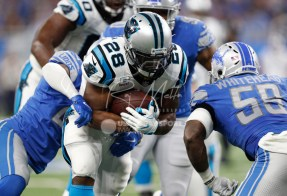 Oct 8, 2017; Detroit, MI, USA; Carolina Panthers running back Jonathan Stewart (28) runs the ball against Detroit Lions outside linebacker Tahir Whitehead (59) during the second quarter at Ford Field. Mandatory Credit: Raj Mehta-USA TODAY Sports