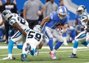 Oct 8, 2017; Detroit, MI, USA; Detroit Lions wide receiver Golden Tate (15) runs after a catch against Carolina Panthers middle linebacker Luke Kuechly (59) and strong safety Mike Adams (29) during the fourth quarter at Ford Field. Mandatory Credit: Raj Mehta-USA TODAY Sports