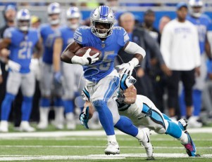 Oct 8, 2017; Detroit, MI, USA; Detroit Lions running back Theo Riddick (25) runs with the ball against Carolina Panthers middle linebacker Luke Kuechly (59) during the fourth quarter at Ford Field. Mandatory Credit: Raj Mehta-USA TODAY Sports