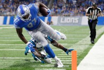 Oct 8, 2017; Detroit, MI, USA; Detroit Lions tight end Darren Fells (87) runs after a catch for a touchdown against Carolina Panthers outside linebacker Shaq Green-Thompson (54) during the fourth quarter at Ford Field. Mandatory Credit: Raj Mehta-USA TODAY Sports