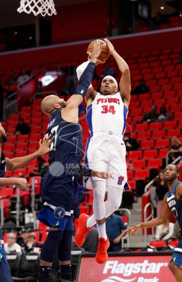 Oct 25, 2017; Detroit, MI, USA; Detroit Pistons forward Tobias Harris (34) takes a shot over Minnesota Timberwolves forward Taj Gibson (67) during the third quarter at Little Caesars Arena. Mandatory Credit: Raj Mehta-USA TODAY Sports