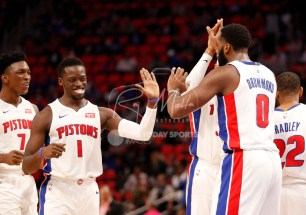 Oct 25, 2017; Detroit, MI, USA; Detroit Pistons center Andre Drummond (0) celebrates with guard Reggie Jackson (1) forward Tobias Harris (behind) and forward Stanley Johnson (7) during the third quarter against the Minnesota Timberwolves at Little Caesars Arena. Mandatory Credit: Raj Mehta-USA TODAY Sports