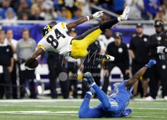 Oct 29, 2017; Detroit, MI, USA; Detroit Lions cornerback Quandre Diggs (28) makes a tackle against Pittsburgh Steelers wide receiver Antonio Brown (84) during the third quarter at Ford Field. Mandatory Credit: Raj Mehta-USA TODAY Sports