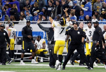Oct 29, 2017; Detroit, MI, USA; Pittsburgh Steelers quarterback Ben Roethlisberger (7) points up after throwing a 97 yard touchdown pass to wide receiver JuJu Smith-Schuster (not pictured) during the third quarter against the Detroit Lions at Ford Field. Mandatory Credit: Raj Mehta-USA TODAY Sports