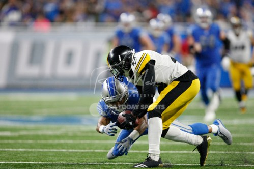 Oct 29, 2017; Detroit, MI, USA; Pittsburgh Steelers cornerback Artie Burns (25) picks up a fumble from Detroit Lions wide receiver Golden Tate (15) during the fourth quarter at Ford Field. Mandatory Credit: Raj Mehta-USA TODAY Sports
