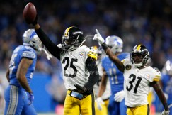 Oct 29, 2017; Detroit, MI, USA; Pittsburgh Steelers cornerback Artie Burns (25) and defensive back Mike Hilton (31) celebrate after a defensive stop during the fourth quarter against the Detroit Lions at Ford Field. Mandatory Credit: Raj Mehta-USA TODAY Sports