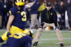 Nov 4, 2017; Ann Arbor, MI, USA; Michigan Wolverines head coach Jim Harbaugh watches place kicker Quinn Nordin (3) warm up before the game against the Minnesota Golden Gophers at Michigan Stadium. Mandatory Credit: Raj Mehta-USA TODAY Sports