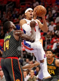 Nov 10, 2017; Detroit, MI, USA; Detroit Pistons forward Tobias Harris (34) goes up for a shot against Atlanta Hawks center Dewayne Dedmon (14) during the second quarter at Little Caesars Arena. Mandatory Credit: Raj Mehta-USA TODAY Sports
