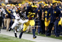 Nov 4, 2017; Ann Arbor, MI, USA; Michigan Wolverines running back Karan Higdon (22) gets tackled by Minnesota Golden Gophers linebacker Jonathan Celestin (13) during the first quarter at Michigan Stadium. Mandatory Credit: Raj Mehta-USA TODAY Sports