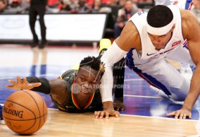 Nov 10, 2017; Detroit, MI, USA; Atlanta Hawks guard Dennis Schroder (17) and Detroit Pistons forward Tobias Harris (34) dive for the loose ball during the fourth quarter at Little Caesars Arena. Mandatory Credit: Raj Mehta-USA TODAY Sports
