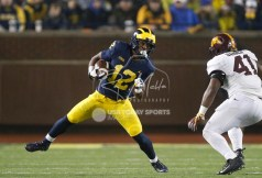Nov 4, 2017; Ann Arbor, MI, USA; Michigan Wolverines running back Chris Evans (12) runs the ball against Minnesota Golden Gophers linebacker Thomas Barber (41) during the fourth quarter at Michigan Stadium. Mandatory Credit: Raj Mehta-USA TODAY Sports