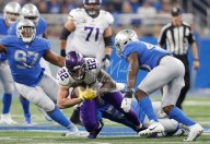 Nov 23, 2017; Detroit, MI, USA; Minnesota Vikings tight end Kyle Rudolph (82) gets brought down after a catch against the Detroit Lions defense during the first quarter at Ford Field. Mandatory Credit: Raj Mehta-USA TODAY Sports