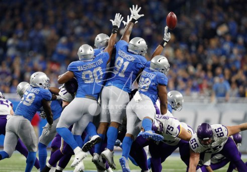 Nov 23, 2017; Detroit, MI, USA; Detroit Lions defensive end Jeremiah Ledbetter (98) blocks a field goal attempt during the second quarter against the Minnesota Vikings at Ford Field. Mandatory Credit: Raj Mehta-USA TODAY Sports