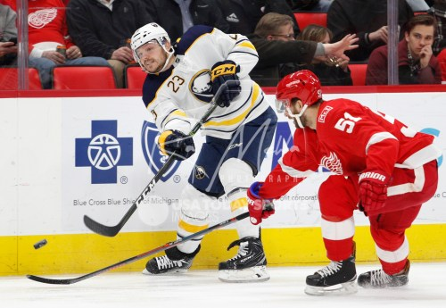 Feb 22, 2018; Detroit, MI, USA; Buffalo Sabres center Sam Reinhart (23) gets defended by Detroit Red Wings center Frans Nielsen (51) during the first period at Little Caesars Arena. Mandatory Credit: Raj Mehta-USA TODAY Sports