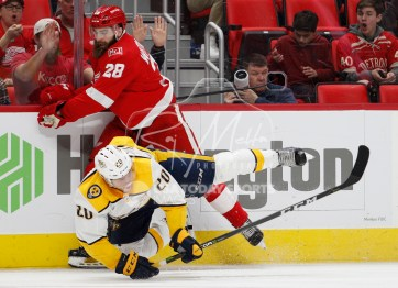 Feb 20, 2018; Detroit, MI, USA; Detroit Red Wings right wing Luke Witkowski (28) knocks over Nashville Predators right wing Miikka Salomaki (20) during the second period at Little Caesars Arena. Mandatory Credit: Raj Mehta-USA TODAY Sports