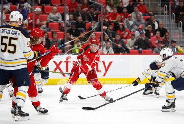 Feb 22, 2018; Detroit, MI, USA; Detroit Red Wings center Dylan Larkin (71) takes a shot during the second period against the Buffalo Sabres at Little Caesars Arena. Mandatory Credit: Raj Mehta-USA TODAY Sports