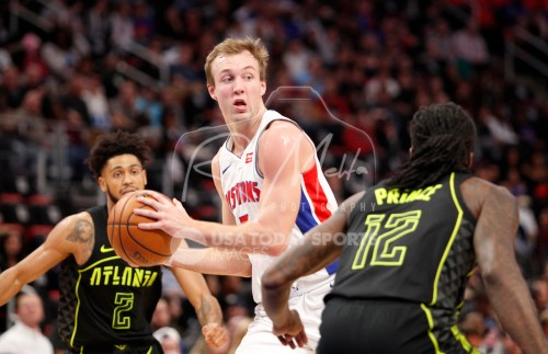 Feb 14, 2018; Detroit, MI, USA; Detroit Pistons guard Luke Kennard (5) looks for an open man against Atlanta Hawks forward Taurean Prince (12) and guard Tyler Dorsey (2) during the second quarter at Little Caesars Arena. Mandatory Credit: Raj Mehta-USA TODAY Sports