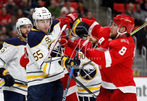 Feb 22, 2018; Detroit, MI, USA; Detroit Red Wings left wing Justin Abdelkader (8) shoves Buffalo Sabres defenseman Rasmus Ristolainen (55) after a play during the second period at Little Caesars Arena. Mandatory Credit: Raj Mehta-USA TODAY Sports