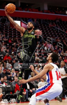 Feb 14, 2018; Detroit, MI, USA; Atlanta Hawks guard Malcolm Delaney (5) goes up for a shot against Detroit Pistons guard Ish Smith (14) during the third quarter at Little Caesars Arena. Mandatory Credit: Raj Mehta-USA TODAY Sports