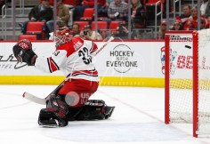 Feb 24, 2018; Detroit, MI, USA; Carolina Hurricanes goaltender Scott Darling (33) gets scored on by Detroit Red Wings defenseman Trevor Daley (not pictured) during the second period at Little Caesars Arena. Mandatory Credit: Raj Mehta-USA TODAY Sports