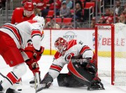 Feb 24, 2018; Detroit, MI, USA; Carolina Hurricanes goaltender Scott Darling (33) makes a save against Detroit Red Wings right wing Anthony Mantha (39) during the second period at Little Caesars Arena. Mandatory Credit: Raj Mehta-USA TODAY Sports