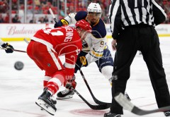 Feb 22, 2018; Detroit, MI, USA; The puck flies behind Detroit Red Wings right wing Luke Glendening (41) after a faceoff against Buffalo Sabres left wing Evander Kane (9) during the third period at Little Caesars Arena. Mandatory Credit: Raj Mehta-USA TODAY Sports