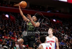 Feb 14, 2018; Detroit, MI, USA; Atlanta Hawks guard Isaiah Taylor (22) goes up for a shot against Detroit Pistons guard Ish Smith (14) and guard Luke Kennard (5) during the third quarter at Little Caesars Arena. Mandatory Credit: Raj Mehta-USA TODAY Sports