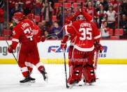 Feb 24, 2018; Detroit, MI, USA; Detroit Red Wings goaltender Jimmy Howard (35) celebrates with teammates after the game against the Carolina Hurricanes at Little Caesars Arena. Mandatory Credit: Raj Mehta-USA TODAY Sports