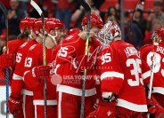 Feb 24, 2018; Detroit, MI, USA; Detroit Red Wings goaltender Jimmy Howard (35) celebrates with defenseman Danny DeKeyser (65) after the game against the Carolina Hurricanes at Little Caesars Arena. Mandatory Credit: Raj Mehta-USA TODAY Sports